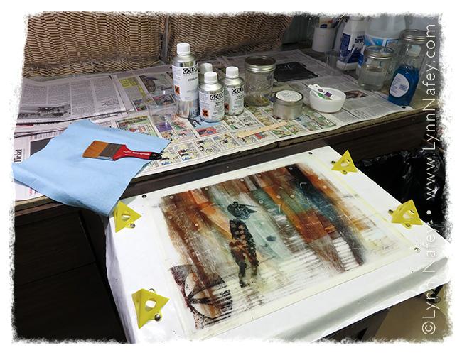 Lynn Nafey - preparing to varnish her mixed media work