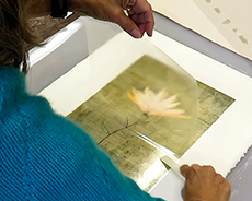 """Lynn Nafey making a pigment transfer print of """"Rising"""", one of her mixed media digital collages"""