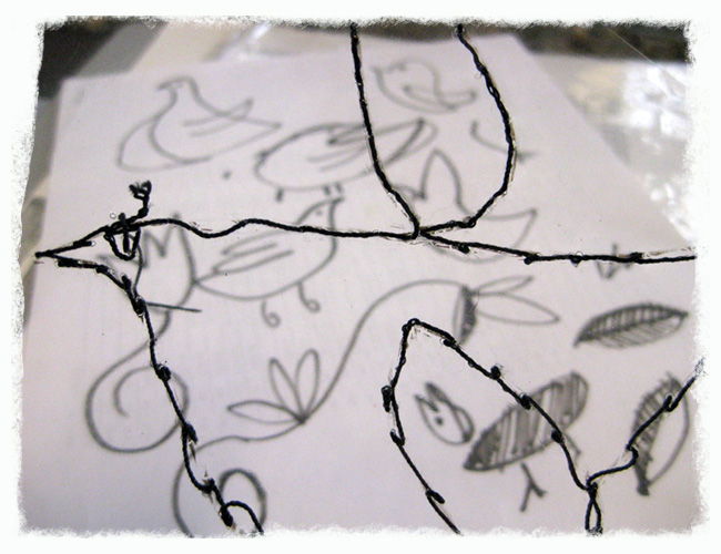 Detail of Stitched Bird On Acetate With Sketches in Background
